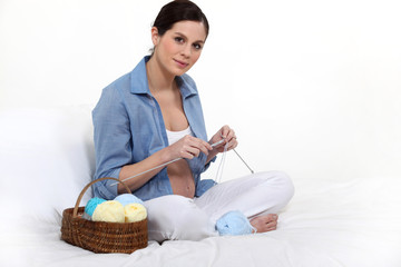 Pregnant woman knitting