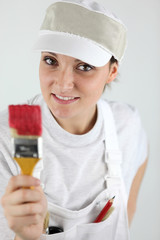 Female decorator holding paint brush