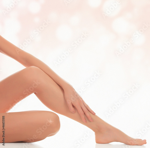 female legs after depilation, abstract blurred background