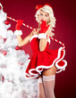 Beautiful blonde woman in Santa costume