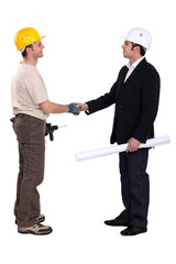 Construction workers greeting each other