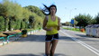 Beautiful woman jogging on the street dolly shot