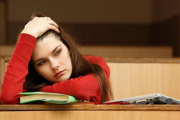 student teen girl beautifyl tired in empty classroom university
