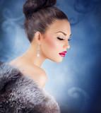 Winter Girl in Luxury Fur Coat. Fashion Fur. Jewelry