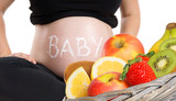 pregnant woman with fresh fruits