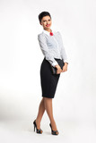 Smiling stylish successful business woman with notepad