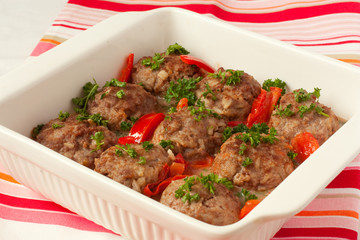 meatballs with begetables in white pan