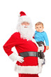 Santa Claus and small child posing