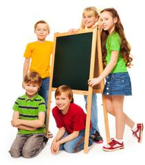 group of schoolboys and schoolgirls with blackboard