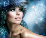 Winter Christmas Woman Portrait. Beautiful Girl in Fur Hat