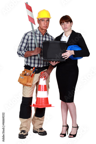 Labourer and engineer working together