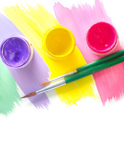 Color paints and brushes isolation on white background