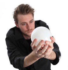 Man looking into a glass ball