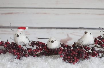 Three Faux White birds, berries, a santa hat and snow