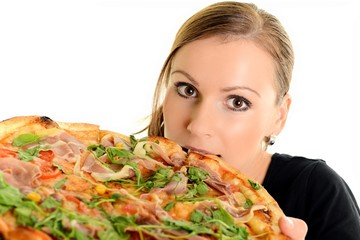 Woman eating pizza, isolated on white
