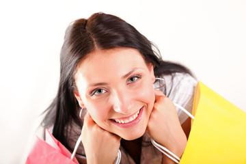 Beautiful shopping woman happy holding bags