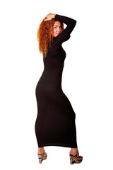 Young beautiful red-haired woman in black dress.