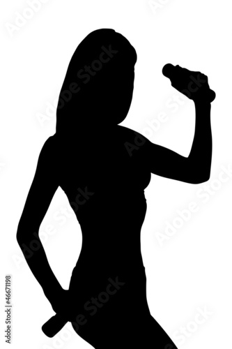 Silhouette of a attractive woman posing with weights