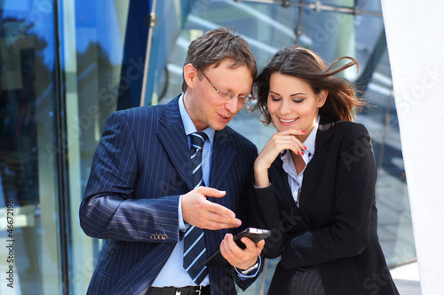 A couple of business persons working in formal clothes
