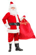 Full length portrait of a Santa Claus holding a bag full of gift