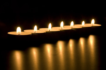 Small candles in dark. Holiday/romance/meditation concept