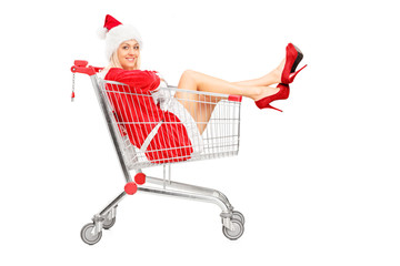 Smiling female wearing christmas costume posing in a shopping ca