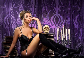 A young and sexy woman on a dark and creepy background
