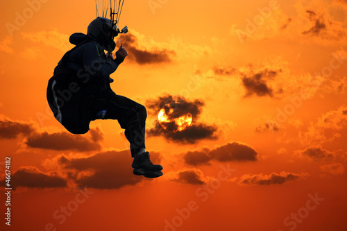 paraglider at sunset