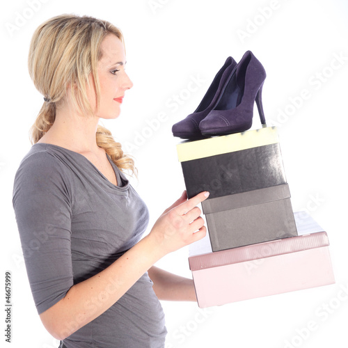 Happy Blonde Woman Holding Boxes of Shoes