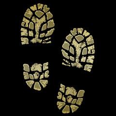 Schuhabdruck gold auf schwarz