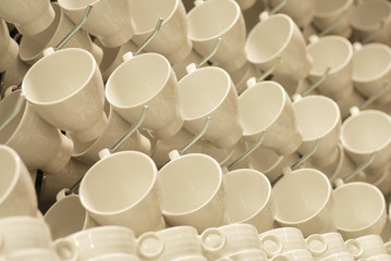Porcelain cups on display rack