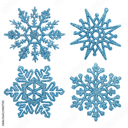 Blue different snowflakes on a white background.