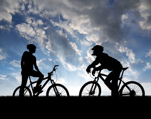 mountain bikers silhouette in sunset