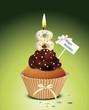Cupcake mit Geburtstagskerze die Zahl 8