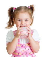 Kid drinking yoghurt from glass