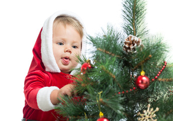 pretty child decorating Christmas tree isolated on white
