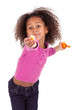 Little African Asian girl sharing a tangerine