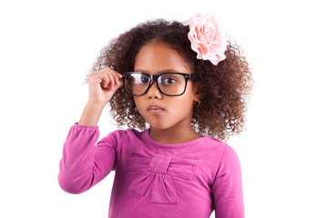 Cute little African Asian girl wearing glasses
