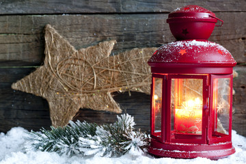 Christma lantern light on wooden boards abstract background