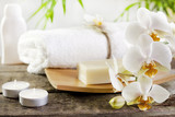 Fototapety Orchids spa soap and towel concept on wooden boards