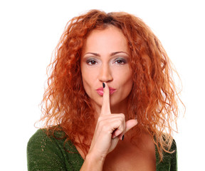 Closeup of redhead woman quiet gesture