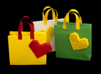 Shopping bags with heart. Isolated origami