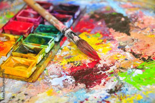 Leinwanddruck Bild Brush dipped in red color