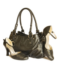 Black bag with shoes isolated on white (with clipping path)
