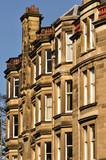 Traditional sandstone Victorian tenement housing in Scotland poster