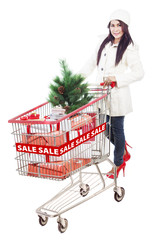 Woman with shopping trolley buying for christmas sale
