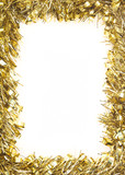 Gold Christmas tinsel, forming border on white background