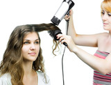 Hairdresser makes hairstyle