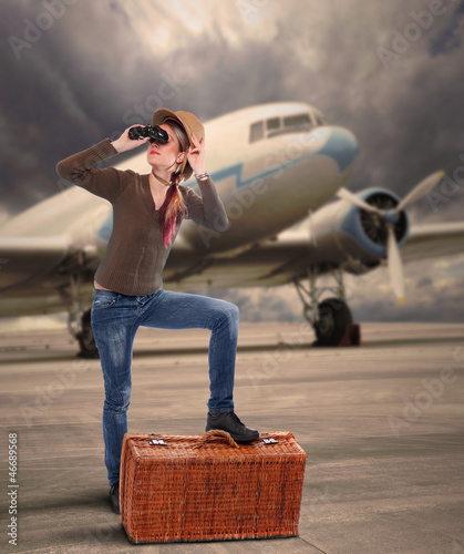 The traveler on the airport against old passenger plane.