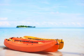 Two kayaks at tropical beach